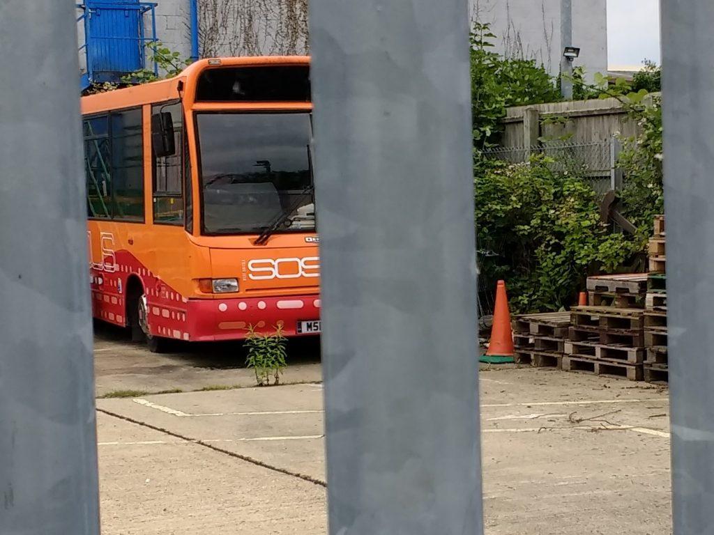 SOS Bus behind bars
